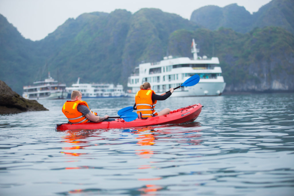 Kayaking in Lan Ha Bay during the overnight cruise trip