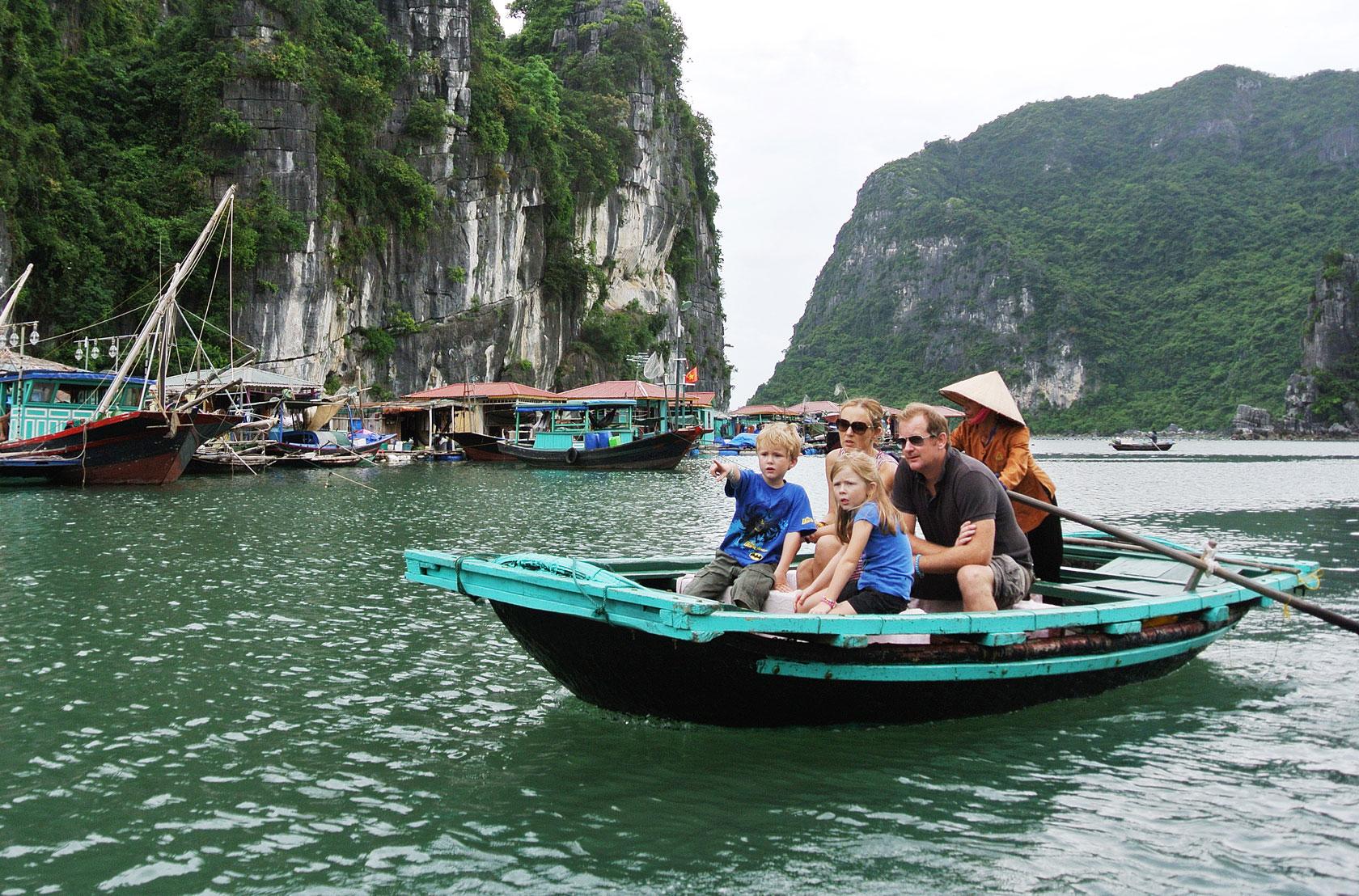Visiting Cua Van Floating Village by boat